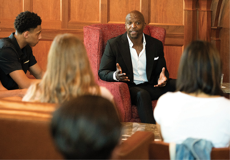 photo of Terry Crews with students