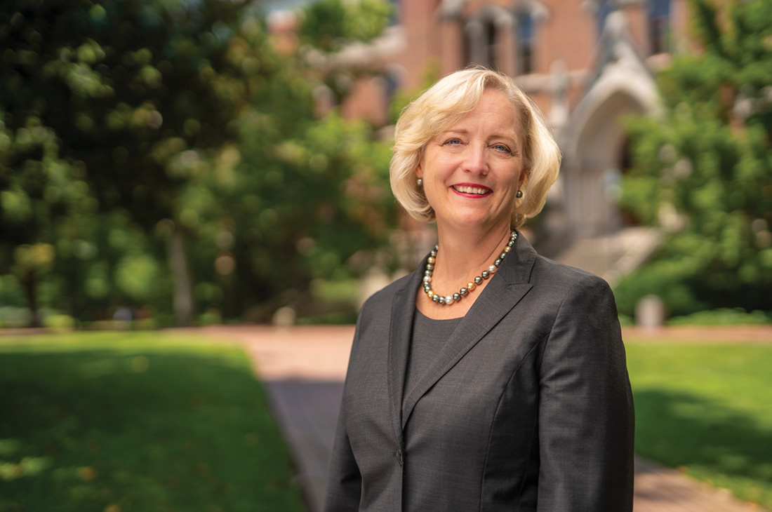 photo of Susan R. Wente in front of Kirkland Hall