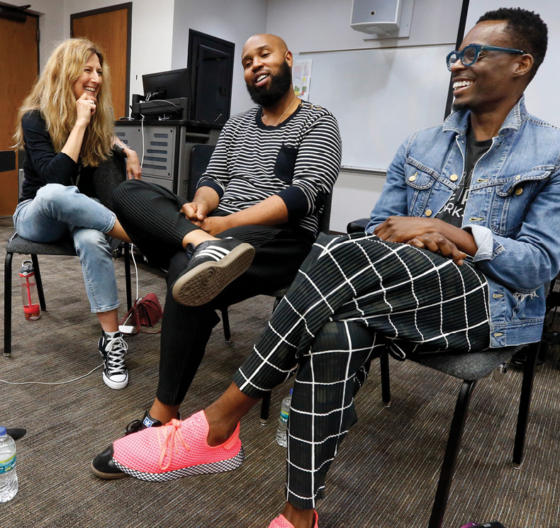 Blair's Deanna Walker, left, welcomes to her songwriting class Claude Kelly, middle, and Chuck Harmony of the duo Louis York. Photo by Steve Green