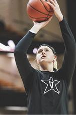 photo of Bree Horrocks shooting a basketball