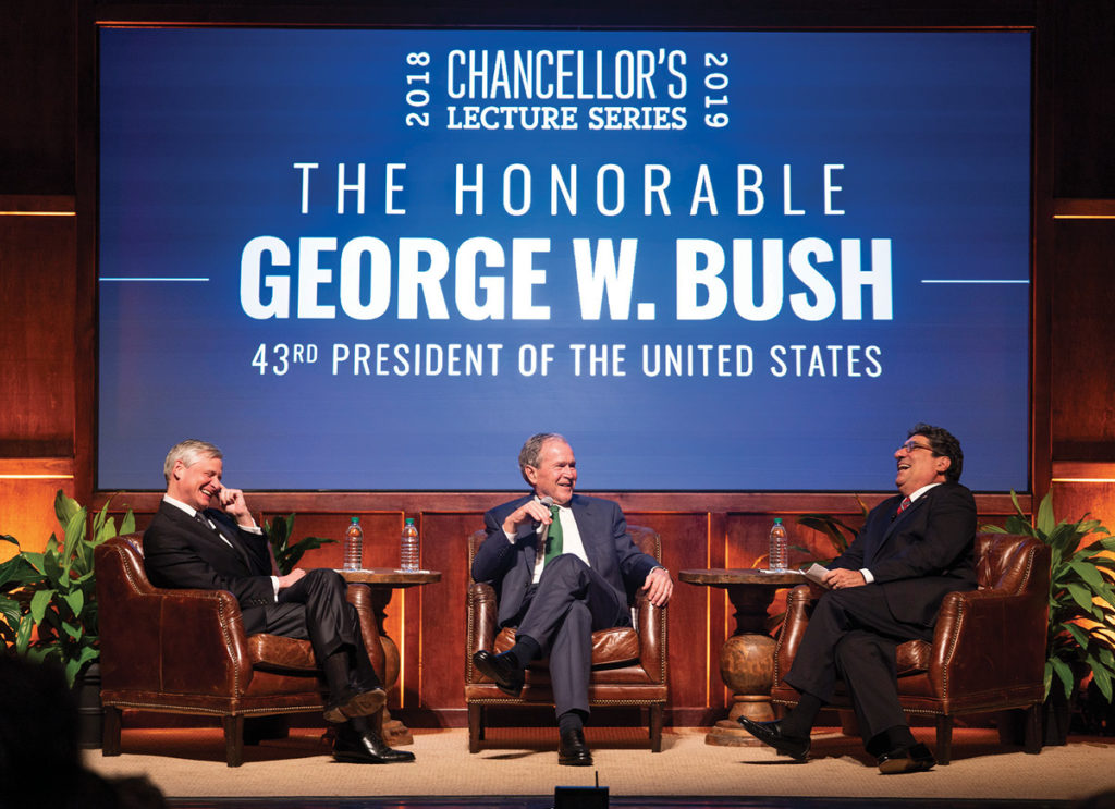 photo of President George W. Bush, Chancellor Nicholas S. Zeppos, and John Meacham talking on stage