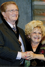 Bradley is inducted into the Country Music Hall of Fame by singer Brenda Lee. Photo by Shauna Bittle/THE TENNESSEAN
